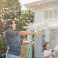 kids spraying hose, water