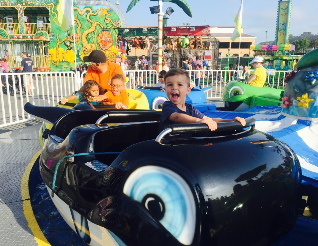 Del Mar Fairgrounds, Fair Food, Fair rides, rainbow grilled cheese, amusement park, carnival, car ride, happy toddler boy