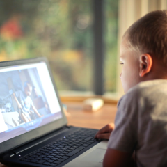 Boy on Laptop, watching video, tutorial, computer learning, online learning