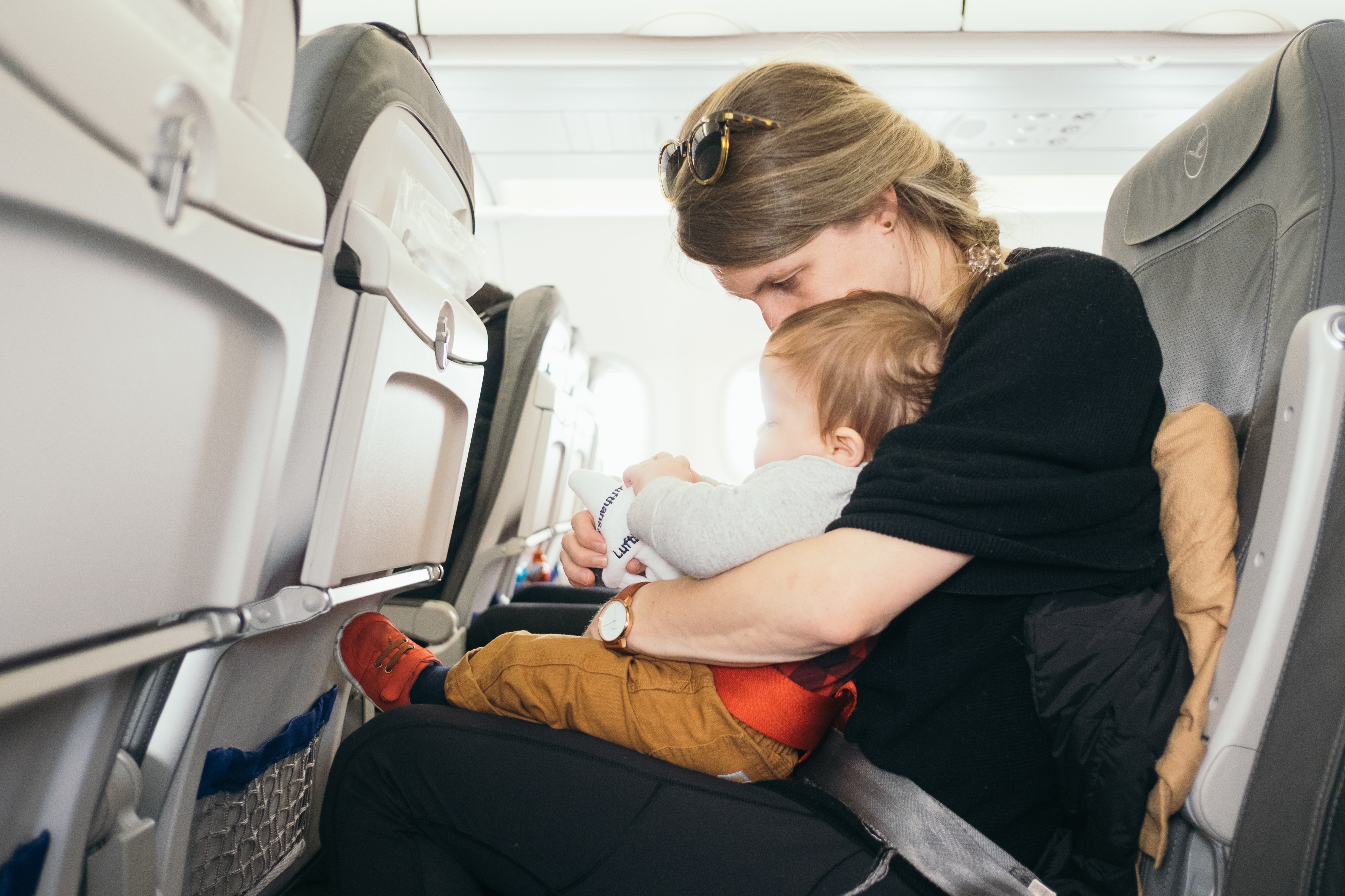 Woman and child on plane