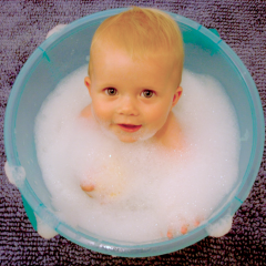 baby in bath with bubbles