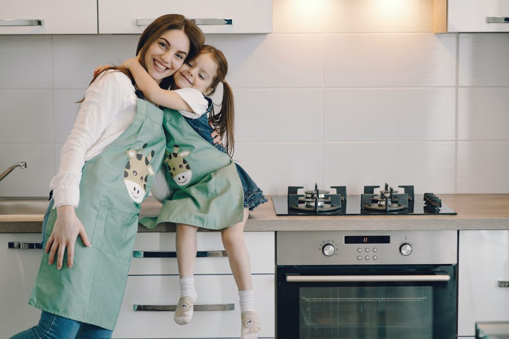 Girl and mom in kitchen