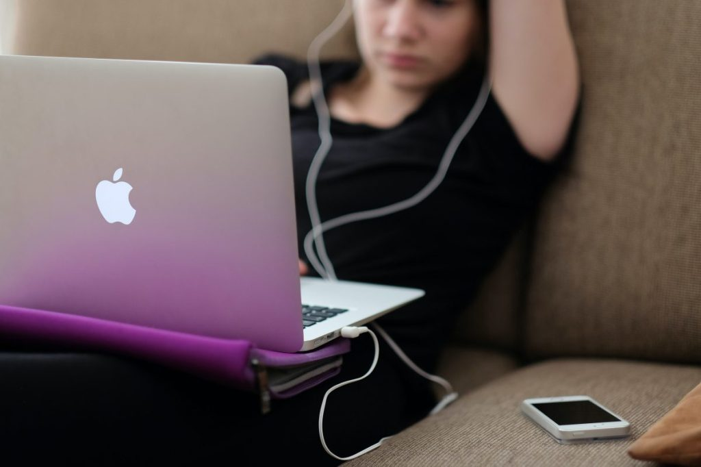 teen on laptop/smartphone