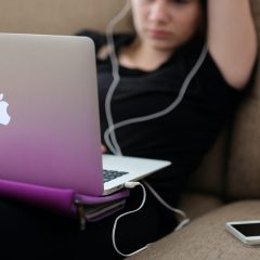 teen on laptop/smartphone