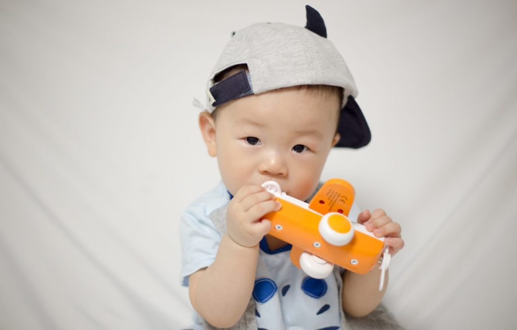 baby with toy plane