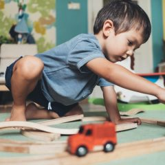 kid-playing-train-tracks-istock