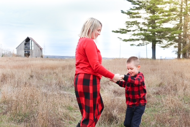 mom and son in a field