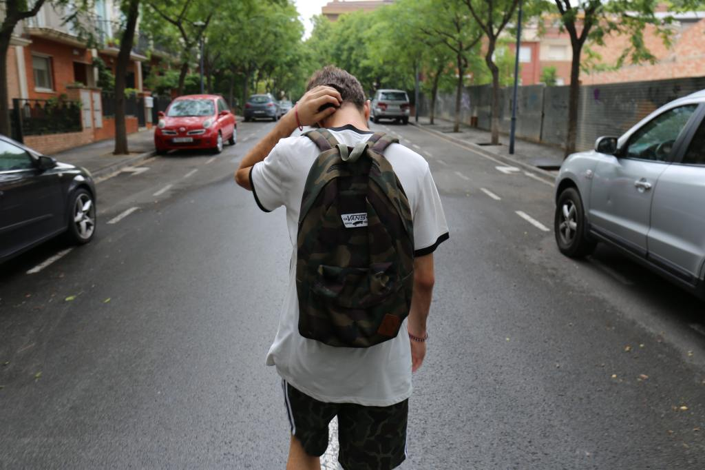 teen with backpack alone