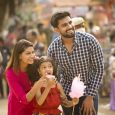 indian-family-festival-fair-cotton-candy-summer-diversity-istock
