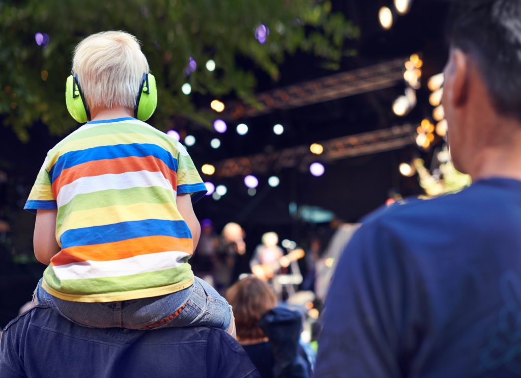 kid-with-headphones-outdoors-festival-music-istock