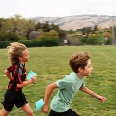 boys running field